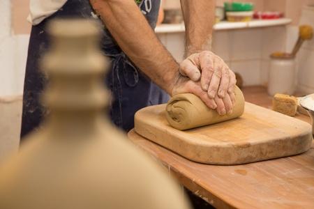 mastication: hands of potter at work