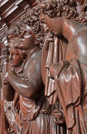 cried: ANTWERP, BELGIUM - SEPTEMBER 5: Carved cried angel in St. Charles Borromeo church on September 5, 2013 in Antwerp, Belgium