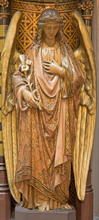 polychrome: ANTWERP, BELGIUM - SEPTEMBER 5: Carved polychrome angel from pulpit of Joriskerk or st. George church on September 5, 2013 in Antwerp, Belgium Editorial