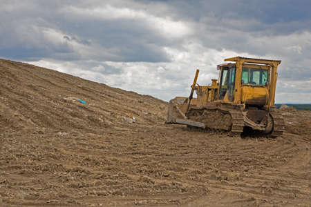 revitalization: bulldozer at revitalization of landfill