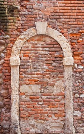 walled: walled door of old house in Verona