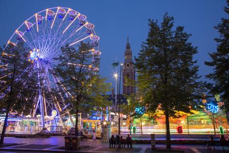 leuven: LEUVEN - SEPTEMBER 3  Amusement park on Monseigneur Ladeuzeplein - square in evening dusk on September 3, 2013 in Leuven, Belgium