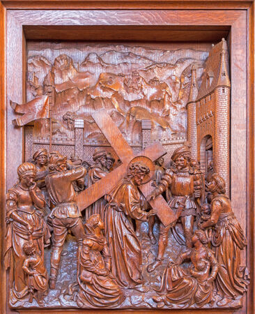 cried: ANTWERP, BELGIUM 5: Jesus with the cross and cried women scene. Carved relief in St. Pauls church (Paulskerk) on September 5, 2013 in Antwerp, Belgium