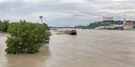 hydrology: BRATISLAVA - JUNE 6: Danube at high flood by highest measured water and SNP bridge and castle on on June 6, 2013 in Bratislava, Slovakia. Editorial