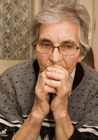 speculation: thinking of old woman - portrait Stock Photo