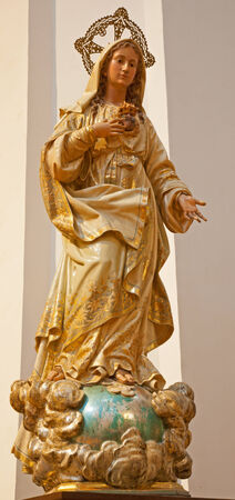 polychrome: TOLEDO - MARCH 8: Carved and polychrome statue of Virgin Mary in San Idefonso church on March 8, 2013 in Toledo, Spain. Stock Photo