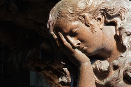 cried: MECHELEN - SEPTEMBER 4: Carved relief of cried angel in Onze-Lieve-Vrouw-va n-Hanswijkbasiliek church on September 4, 2013 in Mechelen, Belgium. Editorial