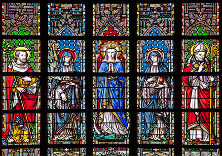 BRUSSELS - JUNE 22  Virgin Mary and saints from windowpane in gothic church Notre Dame du Sablon on June 22, 2012 in Brussels  Redakční