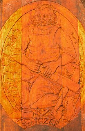 patron: BRATISLAVA, SLOVAKIA - JANUARY 30, 2014  Carved relief of Saint Joseph as clannish patron from wine cellar of great Slovak producer