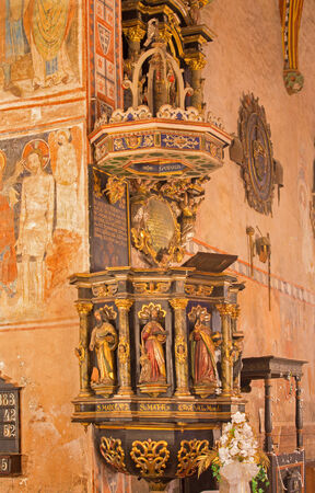 evangelical: STITNIK, SLOVAKIA - DECEMBER 29, 2013: Baroque pulpit from year 1693 with the statue of four evangelists and Jesus in gothic evangelical church in Stitnik.