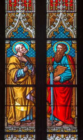 BRATISLAVA, SLOVAKIA - JANUARY 14, 2014: Apostle Peter and Paul on windowpane from 19. from manufactures of Karola Geyling and Eduarda Kratzmann in st. Martin cathedral.