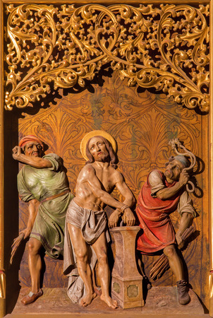 flagellation: BRATISLAVA, SLOVAKIA - JANUARY 14, 2014: Flagellation of Jesus scene. Carved relief from 19. cent.  by Ferdinand Prinoth from St. Ulrich on gothic side altar in st. Martin cathedral. Editorial