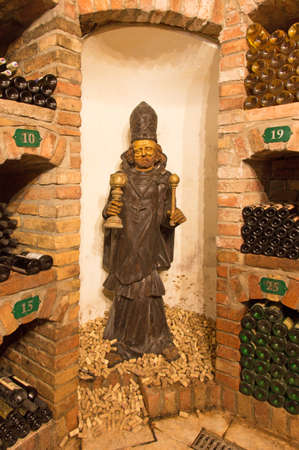 bod: BRATISLAVA, SLOVAKIA - JANUARY 23, 2014: Saint Urban carved statue from interior of wine cellar of great Slovak producer.