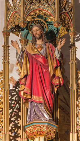 BRATISLAVA, SLOVAKIA - JANUARY 14, 2014: Heart of Jesus Christ. Carved statue from 19. cent. by Ferdinand Prinoth from St. Ulrich on gothic side altar in st. Martin cathedral.