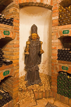bod: BRATISLAVA, SLOVAKIA - JANUARY 23, 2014  Saint Urban carved statue from interior of wine cellar of great Slovak producer
