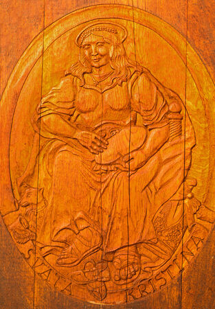 christine: BRATISLAVA, SLOVAKIA - JANUARY 30, 2014  Carved relief of Saint Christine as clannish patroness from wine cellar of great Slovak producer  Editorial