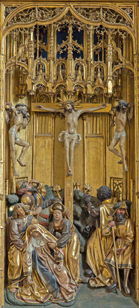 primarily: VIENNA, AUSTRIA - FEBRUARY 17, 2014: Crucifixion panel as detail from gothic carved wings altar in Church of the Teutonic Order or Deutschordenkirche from year 1520  primarily from Mechelen.