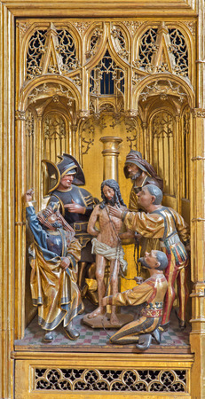 VIENNA, AUSTRIA - FEBRUARY 17, 2014: Flagellation of Jesus panel as detail from gothic carved wings altar in Church of the Teutonic Order or Deutschordenkirche from year 1520 primarily from Mechelen. Editorial