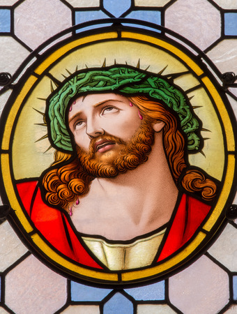 VIENVIENNA, AUSTRIA - FEBRUARY 17, 2014: Jesus Christ with the crown of thorns from windowpane in Carmelites church in Dobling by Geyling workroom from the beginning of the 20. cent.