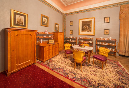 anton: SAINT ANTON, SLOVAKIA - FEBRUARY 27, 2014: Saloon of Luise with furniture from cherry tree from 19. cent. in palace Saint Anton.