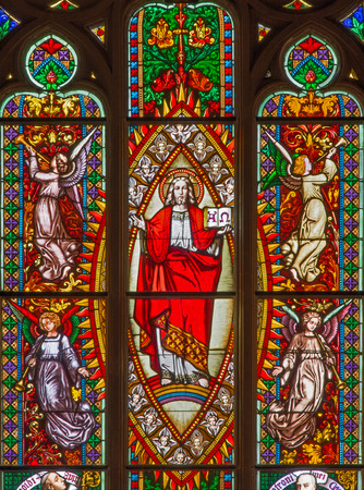 BRATISLAVA, SLOVAKIA - FEBRUARY 11, 2014: Jesus the Pantokrator from windowpane on west portal of st. Matins cathedral  from 19. cent.  from manufactures of Karol Geyling and Eduard Kratzmann,