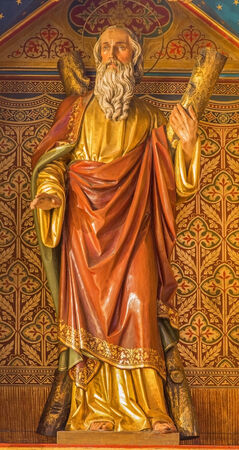 BRATISLAVA, SLOVAKIA - FEBRUARY 11, 2014:  Apostle st. Andrew. Carved statue from 19. cent. by Ferdinand Prinoth from St. Ulrich on gothic side altar in st. Martin cathedral.