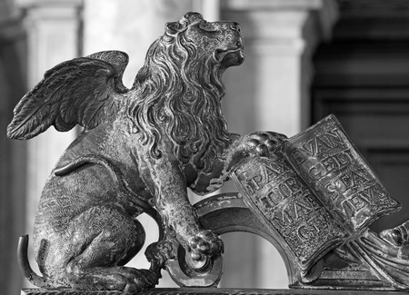 st mark: Venice - Lion bronze statue as symbol of st. Mark the Evangelist - patron of the town from gate of bell tower.