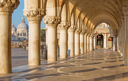 saint mark square: Venice - Exterior corridor of Doge palace and church Santa Maria della Salute in background