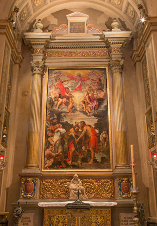 BOLOGNA, ITALY - MARCH 16, 2014  Side altar of Chiesa di San Gregorio e San Siro with the Baptism of Christ scene by Annibale Carracci