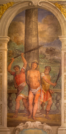 BOLOGNA, ITALY - MARCH 17, 2014: Flagellation of Jesus fresco in baroque church San Michele in Bosco by Bartolomeo Ramenghi from 15. cent..