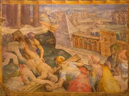 BOLOGNA, ITALY - MARCH 17, 2014: Crucifixion of st. Peter fresco and Decapitation of st. Paul in background in sacristy of baroque church San Michele in Bosco by Prospero Fontana from 16. cent. Editorial