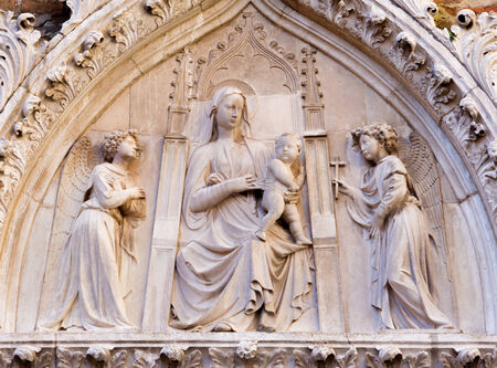 VENICE, ITALY - MARCH 12, 2014: Relief of Madonna on the portal of Church Santa Maria Gloriosa dei Frari.