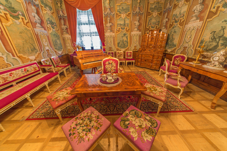 busts: SAINT ANTON, SLOVAKIA - FEBRUARY 27, 2014: Rome saloon from 18. cent. in palace Saint Anton with the handmade needlework on the chairs and textile wallpapers with the busts of Caesars. Editorial