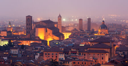 or san michele: Bologna - Outlook to Bologna old town and cathedral San Petronio from church San Michele in Bosco in evening dusk