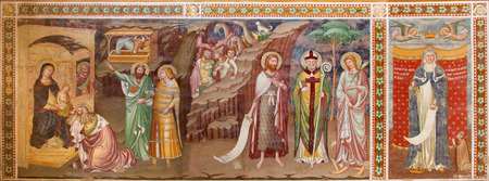 treviso: TREVISO, ITALY - MARCH 18, 2014: Fresco of Adoration of Magi and st. Margaret (1370) in saint Nicholas or San Nicolo church.