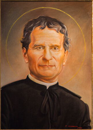 BOLOGNA, ITALY - MARCH 15, 2014: Fine art portrait of Saint Don Bosco by P. Porporato (2008) in Dom - Saint Peters baroque church.
