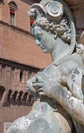 Bologna - Detail of Fontana di Nettuno or Neptune fountain on Piazza Maggiore square photo