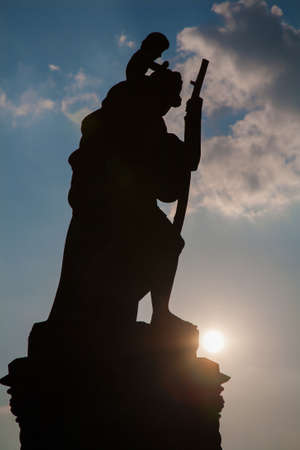 christopher: Prague - Silhouette of st. Christopher statue from Charles bridge
