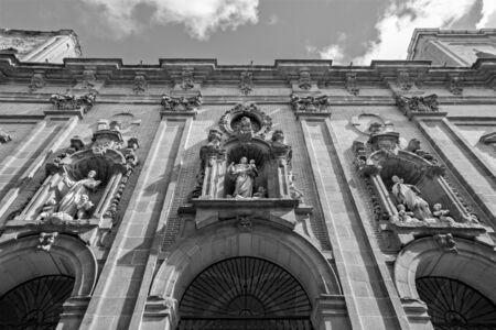 millan: MADRID, SPAIN - MARCH 10, 2013: Facade of baroque church San Millan e San Cayetano.