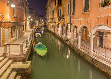 Venice - Canal and the houses with the porticoes in morning dusk