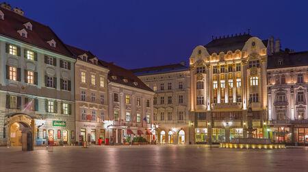 architectonic: BRATISLAVA, SLOVAKIA - JANUARY 23, 2014: Main square in evening dusk with more architectonic styles.