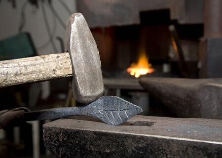 forgeman: Smithy tools - hammer at work Stock Photo