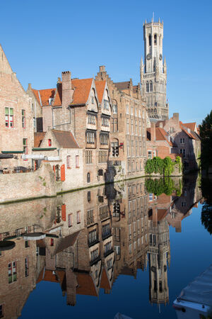belfort: Brugge - View from the Rozenhoedkaai in Brugge with the Perez de Malvenda house and Belfort van Brugge in the background in morning light. Stock Photo