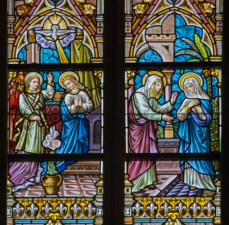 BRUGGE, BELGIUM - JUNE 12, 2014: The Annunciation and the Vistation to Elizabeth scene on the windwopane in st. Jacobs church (Jakobskerk).