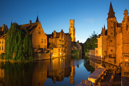 belfort: Brugge - View from the Rozenhoedkaai in Brugge with the Perez de Malvenda house and Belfort van Brugge in the background in the evning dusk. Stock Photo