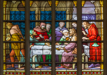 BRUSSELS, BELGIUM - JUNE 16, 2014: Stained glass window depicting Jesus and the twelve apostles on maundy thursday at the Last Supper in the cathedral of st. Michael and st. Gudula.