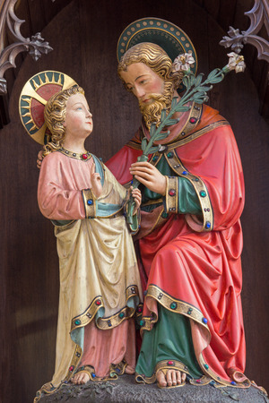 giles: BRUGES, BELGIUM - JUNE 13, 2014: The neo gothic statue of st. Joseph with the little Jesus  in st. Giles (Sint Gilliskerk).