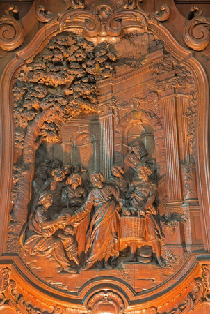 multiplying: MECHELEN, BELGIUM - JUNE 14, 2014: The Carved relief of the Miracle of Multiplying Food by Ferdinand Wijnants in st. Johns church or Janskerk from 17. cent. Editorial