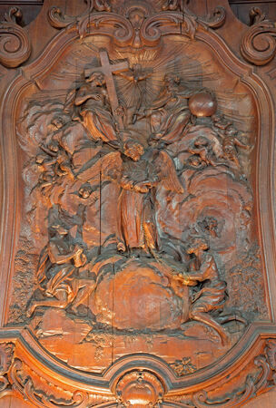 ferdinand: MECHELEN, BELGIUM - JUNE 14, 2014: The carved relief of two slaves with the angel and The Holy Trinity by Ferdinand Wijnants in st. Johns church or Janskerk from 17. cent.