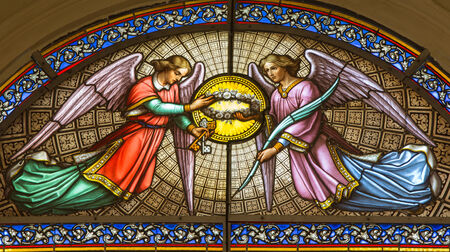 st jacques: BRUSSELS, BELGIUM - JUNE 15, 2014: The Angels from windowpane in St. Jacques Church at The Coudenberg. Editorial